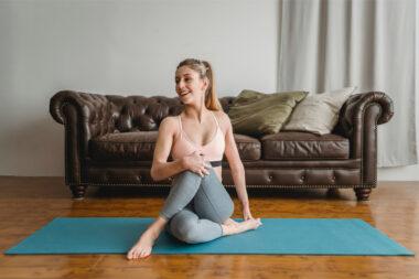 a woman doing yoga for sleep benefits