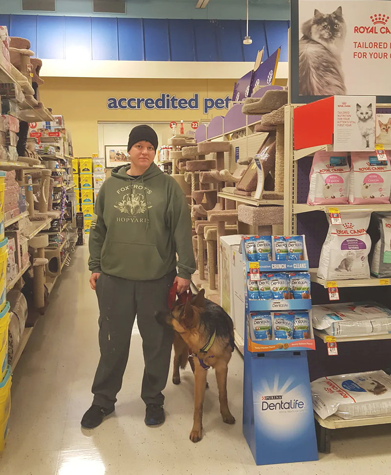 A veteran with a service dog, in a supermarket
