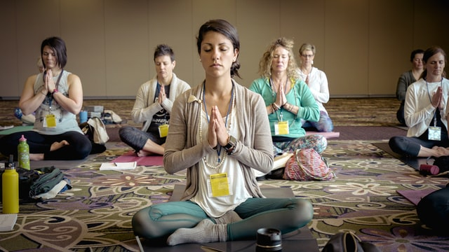 people practicing group meditation